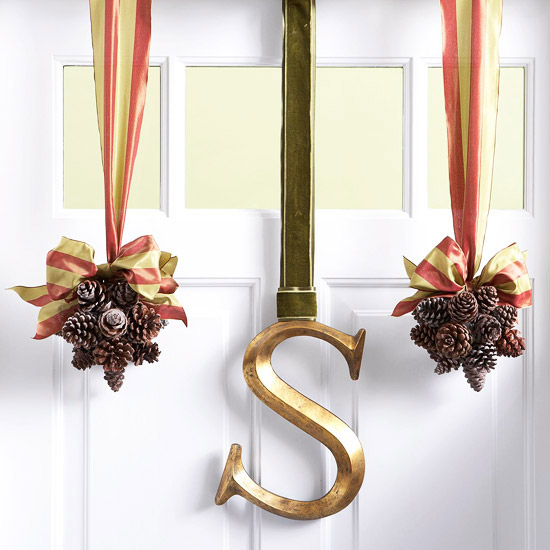Welcome winter hanging pinecones and monogram decor What to hang on front door for decor